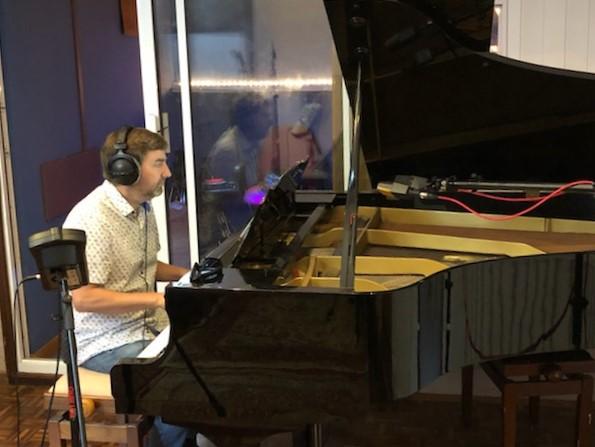 Robert Anwood at a piano